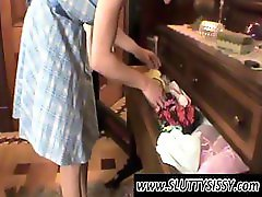 Crossdresser gets his dress lifted up and she plays with his ass