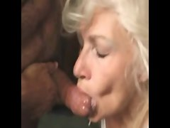 A mature taking a mouthful of cum