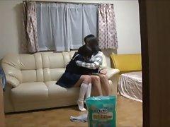 makig her sister wear diaper